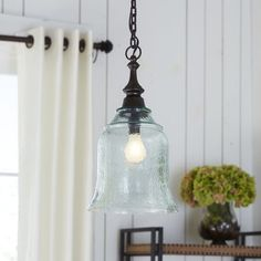 Our artful approach to ambience has resulted in this handblown pendant light. Exclusive to Pier 1, this handsome fixture features texture-rich hammered glass and classic fittings with an antiqued bronze finish.