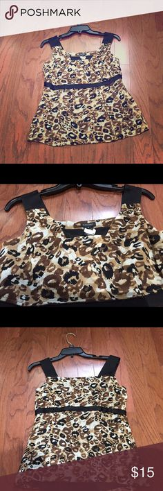 Cheetah print top Beautiful cheetah print top with thick black straps. Flows beautiful below the bust area. Great for casual wear with jeans or shorts for summer style. Nine West Tops Camisoles