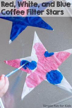 Crafts for Kids: Red, white, and blue coffee filter stars only take minutes to make, and they make great patriotic decorations! (Free template included!)