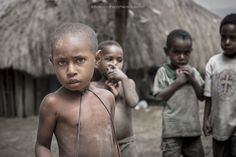 Shy Curiosity - Children of Dani people living in the village of Suroba (Papua).