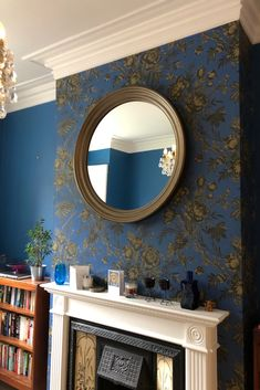 One of our most popular metallic finishes is this hand mixed and hand applied bronze finish. Here, our Large Roma mirror is shown with a flat mirror although convex mirror is also available.  This bronze finish is perfectly matched against this deep blue wallpaper with bronze floral design. Image supplied by our appreciative customer!  #largeroundmirror #roundmirror #roundwallmirror #largewallmirror #bronzemirror #bronze #bigroundmirror Bronze Mirror, Convex Mirror, Round Wall Mirror, Round Mirrors, Extra Large Round Mirror, Mirror Above Fireplace, Dark Green Living Room, Blue Wallpapers