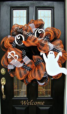 Adventures in Decorating. Want to make this for my door.