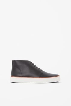 COS image 1 of Raw-cut high sneakers in Black