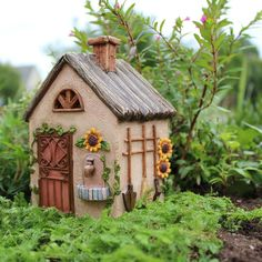 The door opens and closes on this little building. An essential fairy workshop, for fairies to store their tools and wheelbarrows after a hard day in the vegeta
