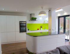 Wren Kitchens - Handleless White Gloss - speaks for itself really! Stunning finish.