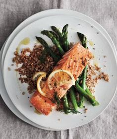 Lemony Baked Salmon With Asparagus and Bulgur recipe: All the ingredients in this 400-calorie meal cook together in a single baking dish.
