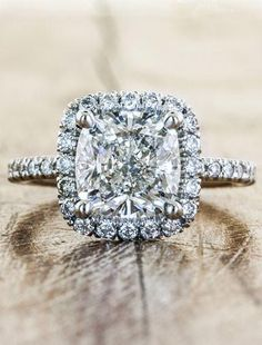 The Janie is a halo cushion cut diamond engagement ring in a delicate diamond-studded setting. by Ken & Dana Design.