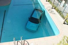 ouch! car in the pool