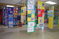 Elementary Art displays  hang from ceiling..use up those poster boards? need round metal circle things