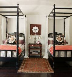 layered linens, black twin four poster beds, @Melissa Reyes