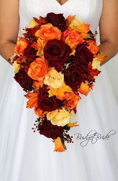 This is a unique fall cascading bouquet made with deep red roses, yellow roses and orange roses all accented with fall leaves Spring Wedding Bouquets, Fall Wedding Bouquets, Fall Wedding Flowers, Fall Wedding Decorations, Fall Wedding Colors, Bride Bouquets, Flower Bouquet Wedding, Wedding Day, Flower Bouquets