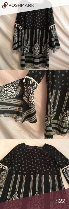 """Almost Famous Shift Dress Black and white print dress with tassel detailing and bell sleeves. Excellent condition. Bust is 18"""" and length is 33"""". Size small. Almost Famous Dresses"""