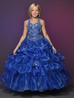 This organza pageant dress by Little Rosie Pageant Dress 625 displays a halter neckline with beautiful beading, basque waistline and a  gorgeous pick up ball gown skirt. Wear this stunning dress for a look to be remembered for your pageant 2011.