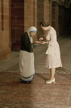 FILE - In this Thursday, Nov. 24, 1983 file photo, the Queen and Mother Teresa look at the Insignia of the Honorary Order of Merit which Her majesty has just...