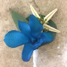 turquoise orchid with starfish and eucalyptus accents #boutonniere