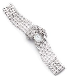 Piaget Rose - Limelight Garden Party watch with case-spring. Case in 18K white gold set with 1023 brilliant-cut diamonds (approx. 8 cts). White mother-of-pearl dial. Bracelet consisting of 130 white Akoya pearls and a clasp set with 93 brilliant-cut diamonds (approx. 0.5 ct). Piaget 56P quartz movement.      Via the Jewellery Editor.