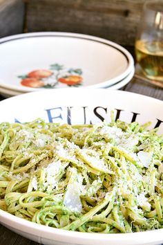 avocado and arugula pesto:  2 medium avocados 2 cups arugula 1/2 cup basil leaves juice from one lime 2 cloves garlic, peeled 1 teaspoon salt 1/2 teaspoon freshly ground black pepper Parmesan cheese for serving Instructions  combine everything in the bowl of a food processor, and pulse until smooth toss with your favorite pasta {we used linguine} serve with the Parmesan