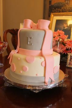 pink and gray girl baby shower cake