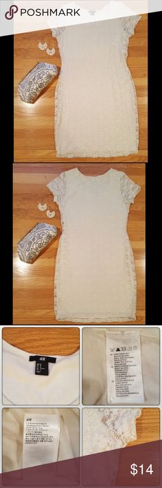 H&M Stretchy Lace Dress Cute ivory stretchy lace dress from H&M. In good used condition. The elastic in the lace frays a bit with wear, but there's still a lot of life left in this dress. Make me an offer. Discount on bundles of 2 or more. H&M Dresses Mini
