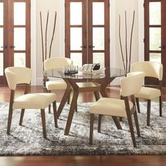 Complete your dining experience with this sophisted table with chairs set. This 5-piece set features a wood frame with a nutmeg finish and is upholstered in a contemporary cream or grey leatherette for a finishing detail.