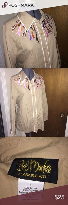 Bob Mackie ribbon blouse Embroidered ribbon design button down by Bob Mackie, wearable art. Designer known for working with Cher. Tan with tan gloss buttons and white trim. No stains or holes. Bob Mackie Tops Button Down Shirts