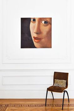 The flooring with the greek key detailing and the close-up of a Vermeer painting juxtaposed with the modern chair.