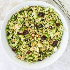 This shaved brussels sprout salad with cherries, hazelnuts and a maple-balsamic vinaigrette is the perfect refreshing side for Thanksgiving!
