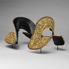 Set of Saddle Plates                                                                                      Date:                                        ca. 1400                                                          Culture:                                        Tibetan or Chinese                                                          Medium:                                        Iron, gold, lapis lazuli, turquoise