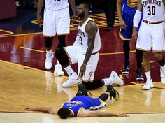 Stephen Curry lies flat on the ground in Game 6 of the NBA Finals after a collision with LeBron James.