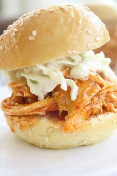 These Shredded Buffalo Chicken Sliders with Blue Cheese Celery Slaw are easy to make and great if you're serving a crowd.