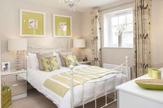 Interior Designed Guest Bedroom using lime green / yellows accents and white - with mirrored side tables. Lime is starting to feature quite prominently at the end of 2014 (David Wilson Homes 2014)