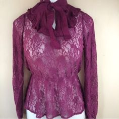 Mulberry floral lace top with necktie Mulberry/plum sheer floral lace long sleeve top features a ruffled bib with tie bow at the neck. Sizes available: S, M, L. 65% cotton/32% nylon/3% spandex. Not interested in trades. L14P18 Tops Blouses