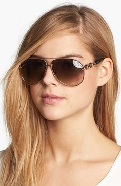 Gucci Brown Gold Bronze Aviators Sunglasses - These sunglasses have an artistic feel about them because of the delicate design. Summer sun is calling out to your aviator sunglasses, check out the light brown tinted aviator frames for women as seen here on the model.