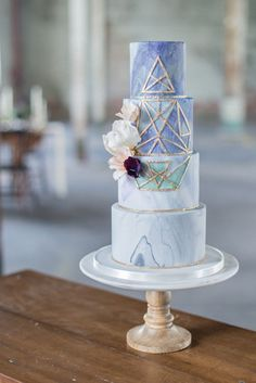 geometric wedding cake - photo by Laura Kelly Photography http://ruffledblog.com/industrial-bohemian-geode-wedding