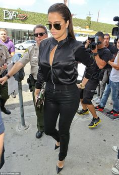 Khloe Kardashian looks better than ever in an all black ensemble for a Wednesday outing to DASH in LA
