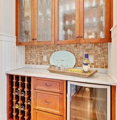 aged mirror panels, vintage look in kitchen.....from 17 Unique Kitchen Backsplash Materials (Cultivate.com)