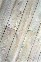Bleaching hardwood floors will lighten stains and age marks.