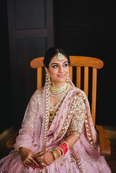 Bride- Portrait - Bride in a Soft Pink Lehenga with Golden Embroidery and Pearl and Gold Jewelry  Photo by: Ombre by Harsheen Jammu | WedMeGood #wedmegood #indianbride #indianwedding #pinklehenga #lehenga #bridal #gold #bridalportrait
