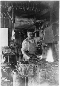 LABOR: Blacksmith making a horseshoe, 1909. | They are becoming less numbered in the cities, but still a necessity, nationwide. Many blacksmiths turned to auto repair.