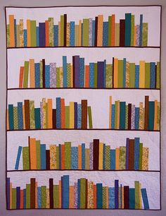 Someone talented should make me this ~ Book Shelf Quilt--OR just make a small wall hanging & embroider favorite book titles on spines:)