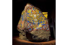 This is a jelling stone, Viking, with runic inscriptions around the tenth century to memorialize King Gorm's wife