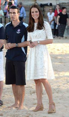 On the beach in Australia in This Eyelet Zimmermann Dress.