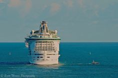 Freedom of the Seas gets a helping hand out to sea.