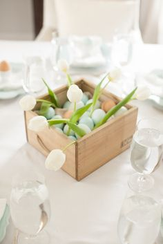 Easy Easter centerpiece filled with eggs and tulips. Get the details at www.julieblanner.com