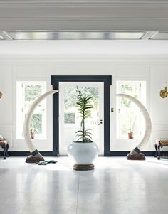 """Cornelia Guest's Templeton Estate in Photos. """"The front hall showcases elephant tusks from one of Winston Guest's hunting expeditions."""""""