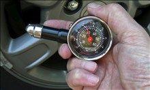 car repairs you should never skip  Tire Pressure Gauge (© Charles Plueddeman)