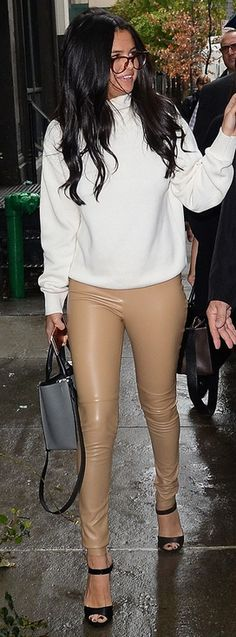 Selena Gomez in a white turtleneck, nude faux-leather leggings and heels