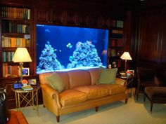 Image 9 of 20 from gallery of Cool Aquarium Design Ideas for House Decoration. Fabulous aquarium design idea house with coral decoration idea for interior house design with yellow sofa between round nightstand in front of aquarium idea Aquarium Design, Big Aquarium, Home Aquarium, Aquarium Ideas, Aquarium Setup, Home Room Design, Decor Interior Design, Living Room Designs, House Design