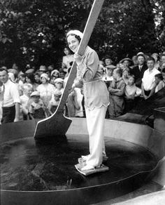 Woman skating in a giant frying-pan with slabs of bacon tied to her feet, ca. 1930. ☀