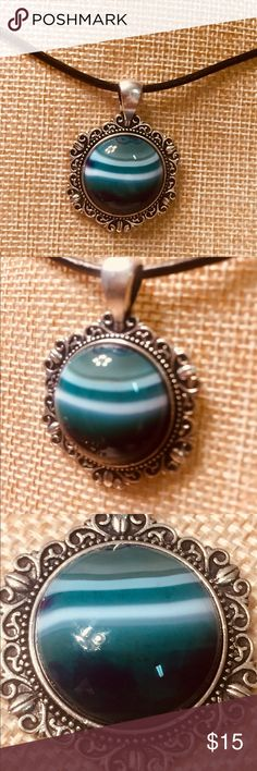 Green Teal Purple White Striped Agate Necklace I loved the gemstone the moment I saw it and mounted it in an Antiqued Silver bezel with a decorative back, and because of its crisp clear bands of color and high contrast, I gave it a round black genuine leather 21-inch cord with a 2- inch extension.  It's a sharp beautiful little gem you can layer with other favorites to bring out your artsy side. JK Designs Jewelry Necklaces